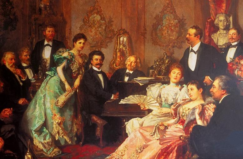 """Im Goldmark-Museum von Deutschkreutz ist auch eine Kopie des Gemäldes """"Ein Abend bei Johann Strauss"""" von Franz von Bayros zu sehen. Goldmark – prominent in der Bildmitte neben dem am Klavier sitzenden Strauss platziert – war Ende des 19. Jahrhunderts ein sehr erfolgreicher Komponist und v.a. durch seine Oper """"Die Königin von Saba"""" auch international bekannt. (Foto: B. Denscher)"""